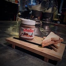 Nutella Cocktail in a Nutella jar and served with Nutella toast at the side.