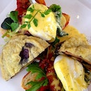 Poached Egg on Muffin with Tempura of Portobello, Streaky Bacon and Spinach, Dill Hollandaise Sauce