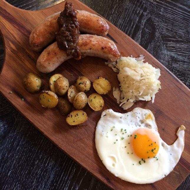Grilled Sausage with Sauerkraut, Sautéed Potatoes, Fried Egg and Onion Jam $23