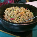 Issaya's wok sautéed short grain rice, served in a hot stone pot,  tasted flavorful and healthy