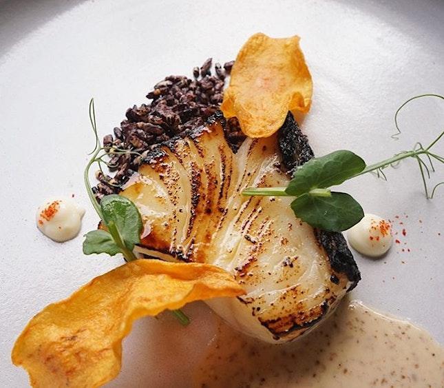 Sweet miso black cod with pulut hitam furikake and sweet potato crisps.