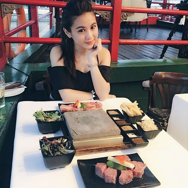 Dining experience on a (non-moving) boat, whereby cooking of the meat is done on the sizzling hot stone slab.