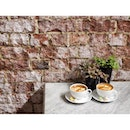 Sunday coffees and a pretty brick wall.