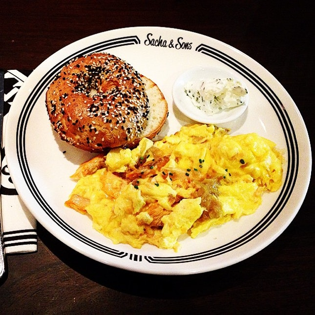 Toasted Bagel with smoked salmon and caramelised onion scrambled egg.
