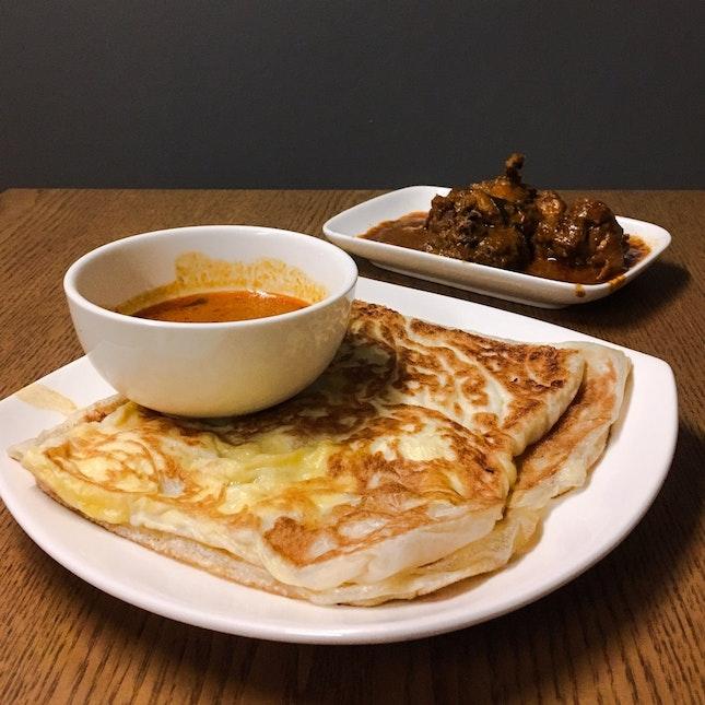 Cheese & Egg Prata, Garlic Prata (foreground), Curry Chicken (background)