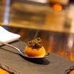 Smoked quail egg with caviar.