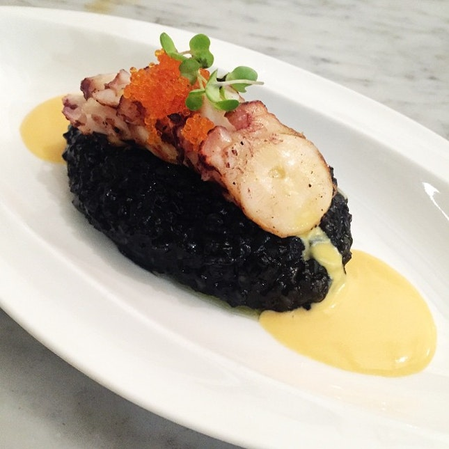 Grilled house poached octopus, squid ink risotto, salted egg sauce topped with tobiko.
