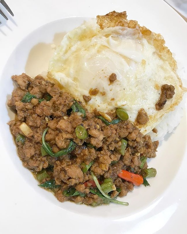 Pad Krapao - Minced Pork with Thai Basil and an egg over steaming hot white rice 👍🏻 .