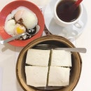 Traditional Morning Goodness: soft boiled eggs, teh-o kosong and steamed kaya butter bread.