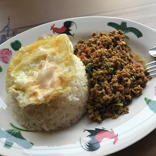 Rice with basil chicken bits.