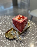 Strawberry tiramisu in a marble box.