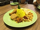 Tumpeng Mini - The fragrant yellow rice set comes with Ayam bumbu rujak, Perkedel(fried potatoes with some minced meat fillings and etc), Potato peanut and pickles.