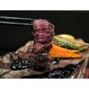 Charcoal grilled Motobu Wagyu Steak with Miso on houba leaf from En Grill and Bar.