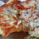 Hand opened Italian Thin Crust Pizza@equilibrium.sg with tomato sauce, Mozzarella, bacon, onion and bell peppers @equilibrium.sg.