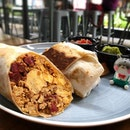 The hefty Breakfast Burrito packed with all you need for the day - scrambled eggs, cheese, spanish chorizo, potatoes, and some chipotle puree to spice things up!