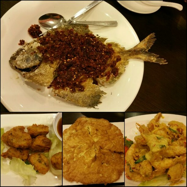 Fried Sambal Promfret, Salty Egg Prawns, Seafood Omlette And Signature Beancurd Roll