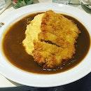 Pork Katsu with omelette rice .