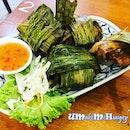 4 pcs of pandan chicken on a plate .