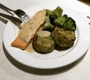 Salmon Fillet with Vegetables medallion, broccoli and lemon with dill sauce .