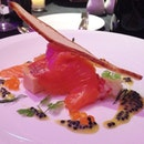 Smoked trout parfait and lobster medallion with avruga caviar dressing.