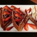 Strawberry waffles with gelato ice cream