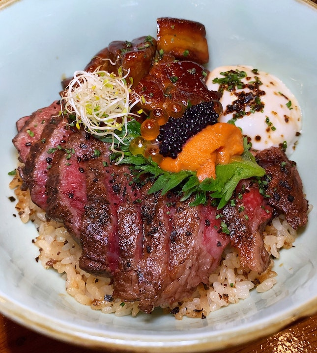 Question: What's 牛 (níu) about the Fat Cow Premium Donburi?