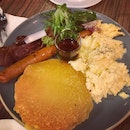 Pancakes With Scrambled Eggs, Bacon And Sausage