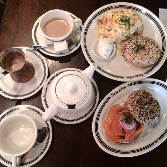 Bagel with Gravlax, Herb Cream Cheese, Onions, Capers x Scrambled Eggs with Smoked Salmon, Caramelized Onions