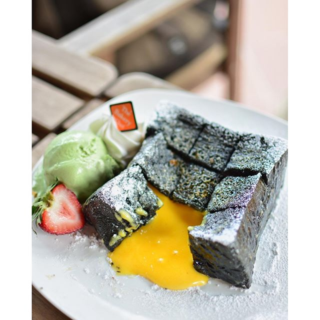 Charcoal Liu Sha Toast with matcha ice cream.