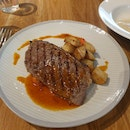 Striploin Steak (150g) with Roast Potatoes and Greens ($12)