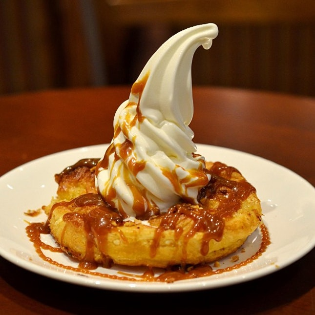 'Little Fuji' - vanilla soft serve on crisp butter danish pastry with a viscous caramel sauce generously drizzled across.