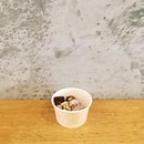 Soy Strawberry Yogurt topped with Red Velvet Cheesecake Brownies, Toasted Muesli and Mango Pearls  The yogurt was smooth, balanced and had a distinct strawberry flavour, that gains a deep and rich taste, crunch and a outburst of another fruity flavour from the other toppings!