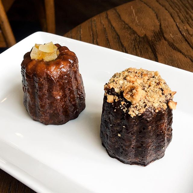 Medium Sized Mediterranean & Hazelnut Caneles  The Mediterranean Canele comes flavoured in Grand Marnier on the centre and topped with orange zest, while the Hazelnut Canele comes infused in chocolate custard, topped with chopped Italian Hazelnut.