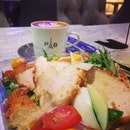 Chicken salad and cappuccino.