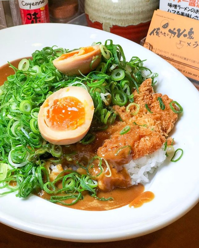 A mouthwatering plate of piping hot Japanese curry over a bed of rice with a freshly breaded and deep fried pork cutlet, an addition of egg and a generous portion of spring onion makes this meal a super comforting one.