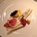 White asparagus with caviar, Manchego, saffron sauce and Jamon.