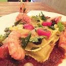 Seafood Ravioli with Tomato Basil ($28) Seafood and ricotta chez ravioli with tomato basil sauce.