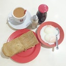 Value Set Meal A ($4.80) - Kaya Butter Toast Served with 2 half boiled eggs and a cup of tea.