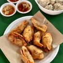 Fried Dumplings/ 三鲜锅贴 ($4 for 8 pieces)