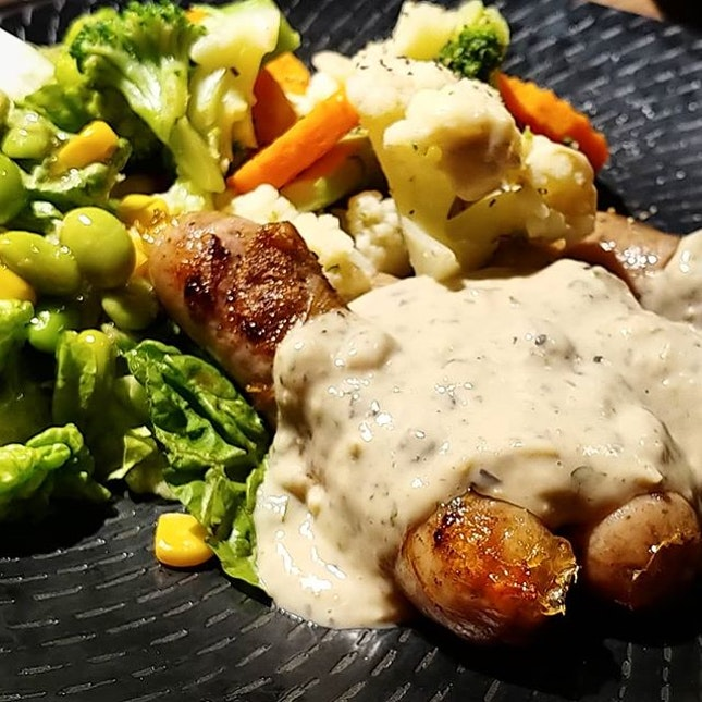 From #thegrillknife  Not Sausages, but juicy savory Bratwursts, blanketed with creamy house special sauce, accompanied with 2 choice of sides; 1 order with veges & beans, another with fries & sunny side up.