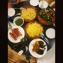 last night's dinner:  mac n cheese, onion sausages,  stir fried brocoli, samal kang kong, ayam penyat and bakar.
