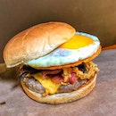 Glorious pork burger, with a beautiful runny egg, crunchy onions, bacon and a crispy layer of parmesan cheese.