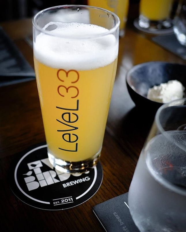 When @twobirdsbrewing nest up at @level33_sg , you get the limited edition Golden Ale that exudes hop forward, flavour intensity of tropical fruits from the Tasmanian hops and drinkability typical of an ale.