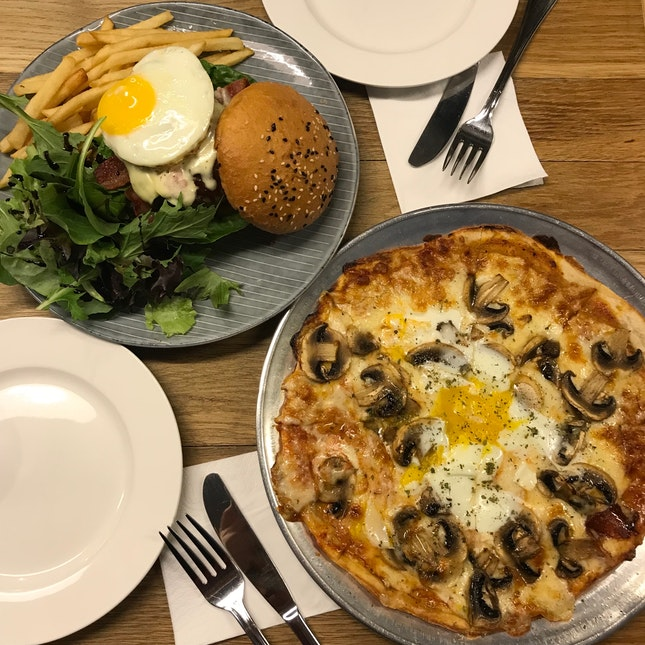 Truffle Scented Mushroom & Egg Pizza ($22), The Assembly Burger ($23)
