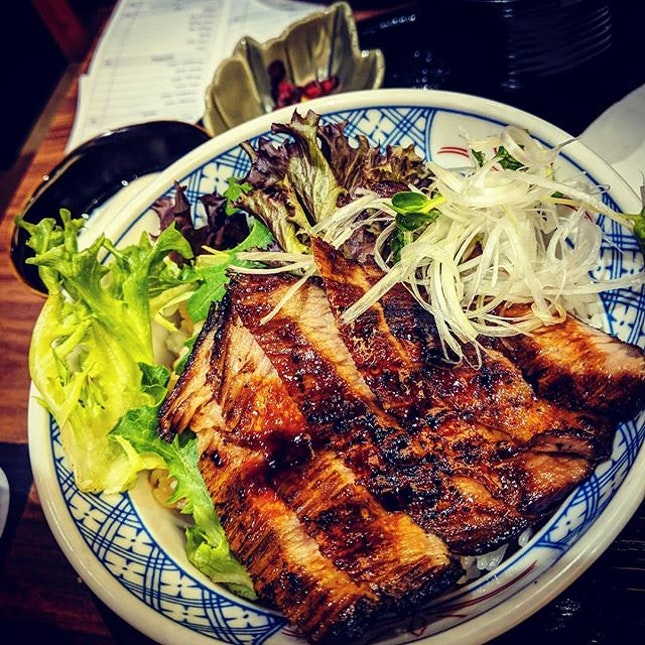 Kurobuta Jowl Don  It is grilled till the nicely marbled fat melts while leaving a slight char on the edges.