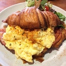 [Ultimate Croissant-$14]  Fluffy scrambled eggs and ham sandwiched between croissant = the perfect brunch dish.