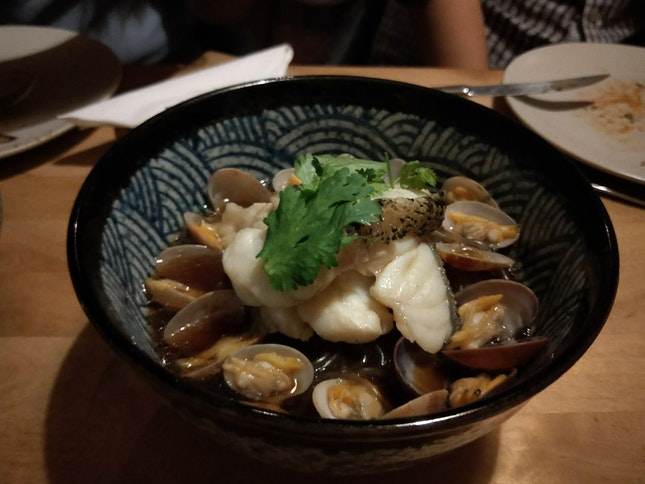 An exquisite bowl of black grouper and clams