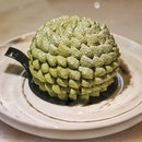 STRAY BY FATCAT, MATCHA WHITE SESAME CAKE  While the appearance of the cake resembles our iconic building the esplanade, it wasn't not made to look like it, nor isit made to look like king of fruits, the durian.