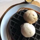 Charcoal Waffle with Two Scoops of Ice Cream and Salted Egg Yolk sauce