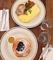 Fluffy blueberry pancakes, Scrambled eggs on toast